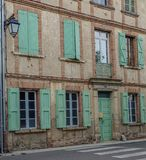Typical facades in houses of the Occitania. Lisle-sur-Tarn, Midi Pyrenees, France - July 17, 2017: Typical facades in houses of the Occitanie in France, in royalty free stock photography