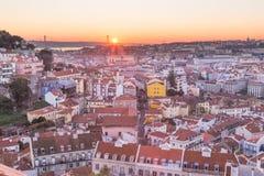 Lissabon cityscape backlit panorama på solnedgången Portugal Royaltyfria Bilder