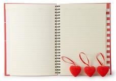 Listín de teléfonos con dos corazones Fotografía de archivo