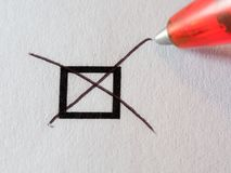 List of checkboxes. Checkbox and red pen ballpoint marking one box on white background Stock Images