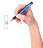 List of checkboxes and hand with pen. On white background Royalty Free Stock Photography