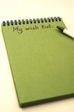 List d'envie del dibujo de la mano en el cuaderno Imagen de archivo libre de regalías