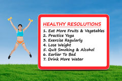 The list of healthy resolutions and fitness woman Stock Photography