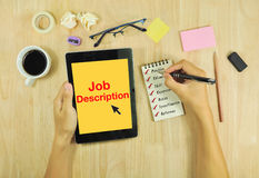 List Job description and look  job on Tablet. Royalty Free Stock Photo