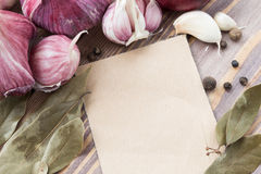 List menu surrounded by red heads of garlic Stock Photo