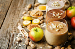 List peanut butter smoothie with chocolate, apples, banana and o. Ats. the toning. selective focus stock images