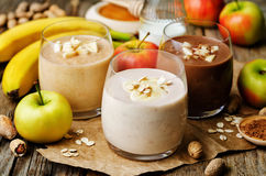 List peanut butter smoothie with chocolate, apples, banana and o Stock Images