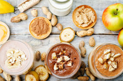 List peanut butter smoothie with chocolate, apples, banana and o. Ats. the toning. selective focus royalty free stock image
