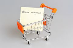 List of purchases in shopping cart on gray Royalty Free Stock Photography