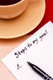 List of steps to the goal. Note on a napkin, plan for achieving a goal Royalty Free Stock Photo