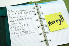 A list of things to do with post it. A list of things to do on notepad with post it, hurry stock photo