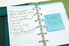 A list of things to do with post it. A list of things to do on notepad with post it, i need time stock image