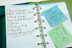 A list of things to do with post it. A list of things to do on notepad with post it, take care about you, enjoy life royalty free stock photo