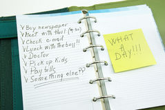 A list of things to do with post it. A list of things to do on notepad with post it, what a day stock photography