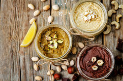 List toasted nut butters, pistachio, hazelnut and cashew Royalty Free Stock Photo