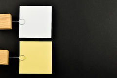 List, Two paper notes with holders on black for presentation Stock Photography