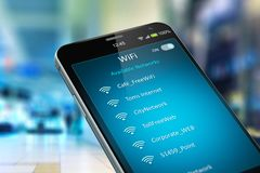 List of WiFi networks on smartphone in the shopping mall Royalty Free Stock Photos