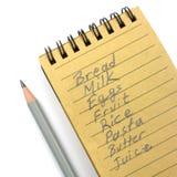 Lista de compras con el lápiz natural del papel y de ventaja Foto de archivo libre de regalías