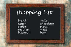 Lista de compras de la pizarra Foto de archivo libre de regalías