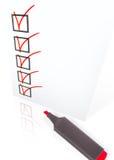 Lista de comprobación con la pluma Fotos de archivo libres de regalías
