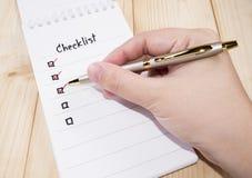 Lista de control en el cuaderno 9 Imagen de archivo libre de regalías