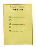Lista de mi plan en el papel con el tablero Imágenes de archivo libres de regalías