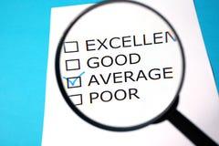 Lista de verificação e lupa do feedback Fotos de Stock Royalty Free