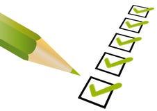 Lista de verificação e um lápis Imagem de Stock
