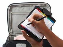 Lista del cheque de viaje Foto de archivo libre de regalías