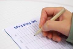 Lista di acquisto di scrittura per la stagione di natale Immagini Stock Libere da Diritti