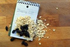 Lista di acquisto - uva passa della farina d'avena Immagine Stock