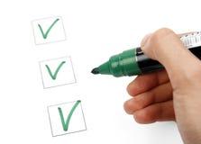 Lista di assegno e dell'indicatore Fotografia Stock