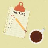 Lista di controllo e tazza di caffè Immagine Stock