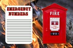 Lista dos números de emergência Fotos de Stock Royalty Free