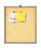 Lista e soldi di acquisto fotografia stock libera da diritti