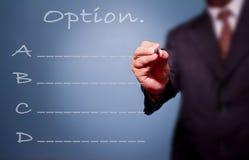 Lista för alternativ för writing för affärsman. Royaltyfri Fotografi