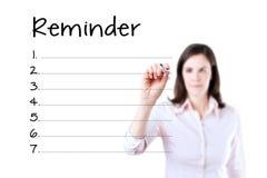 Lista för påminnelse för mellanrum för handstil för affärskvinna som isoleras på vit Royaltyfria Foton