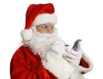 Lista impertinente de Santa em PDA fotos de stock royalty free