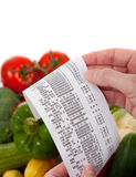 Liste d'épicerie au-dessus d'un sac légumes Images libres de droits