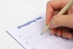 Liste d'achats de saison Image stock