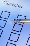 Liste de contrôle et crayon Images stock