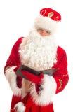 Liste de lecture de Santa de cadeaux Photographie stock libre de droits