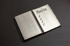 Liste de plans d'action dans le carnet photo stock
