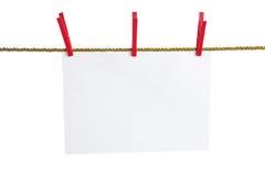 Liste des Papiers auf einem Goldseil Lizenzfreies Stockbild