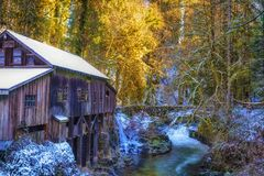 Cedar Creek Grist Mill in Winter. Listed on the national Register of Historic Places, Cedar Creek Grist Mill is a water-powered mill.  It was built in 1876 and Royalty Free Stock Photo