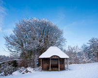 Listed wooden summerhouse on a snowy afternoon Royalty Free Stock Photos