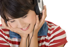 Listen. Concept of young girl with headphone, closeup portrait of Asian with white copyspace Royalty Free Stock Photos