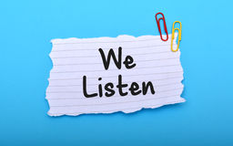 We Listen client services on paper closeup.  Stock Photography