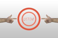Listen command in the center of two circles. Two hands pointing to Listen word. Listen command in the center of two circles. Two hands pointing to Listen word Stock Photo