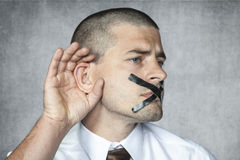 Listen but do not talk. Business man Royalty Free Stock Images